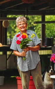 Mary Ellen Damm prepares a flower order for Schnucks Grocery store